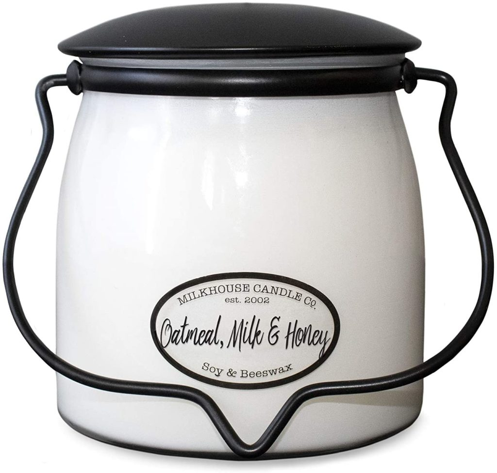 Milkhouse scented soy candle that smells like honey.